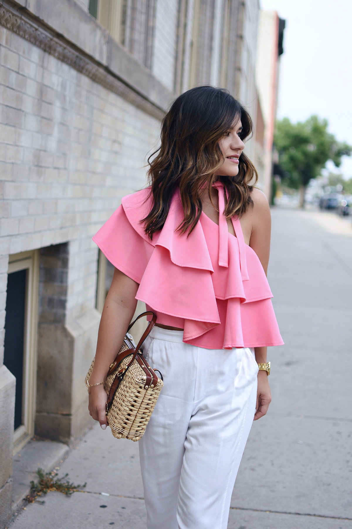 f673f2e0f5d Carolina Hellal of Chic Talk wearing an off the shoulder pink ruffle top  with white pants
